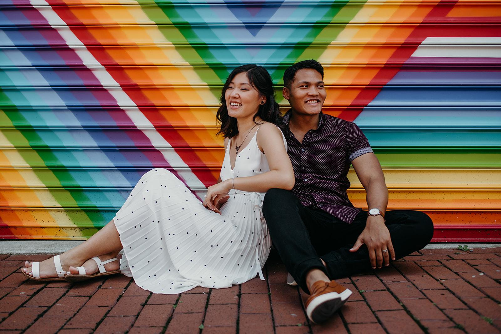 Washington DC love mural engagement session colorful rainbow laugh