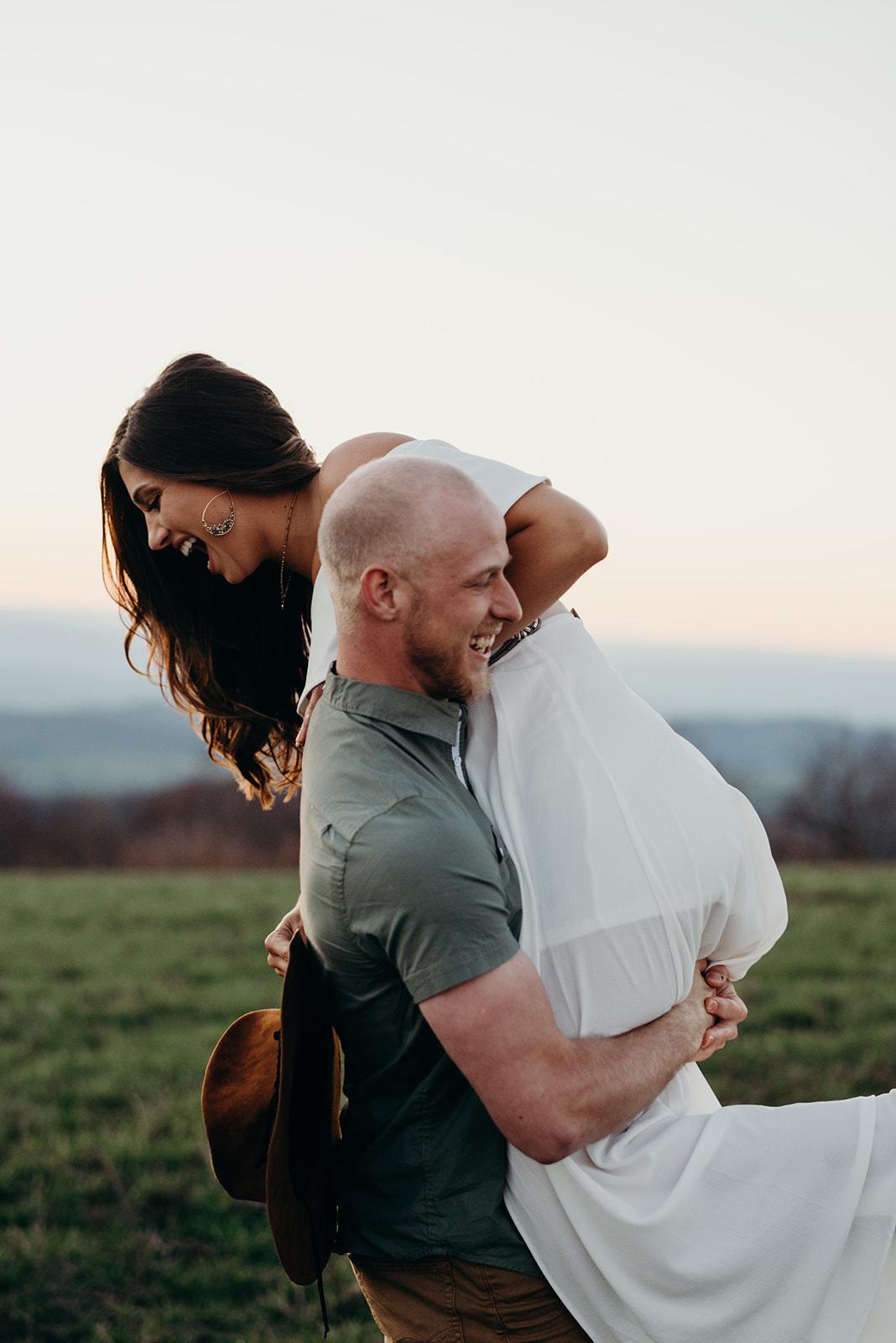 Virginia mountain engagement session Shenandoah valley at sunset fun spinning hug