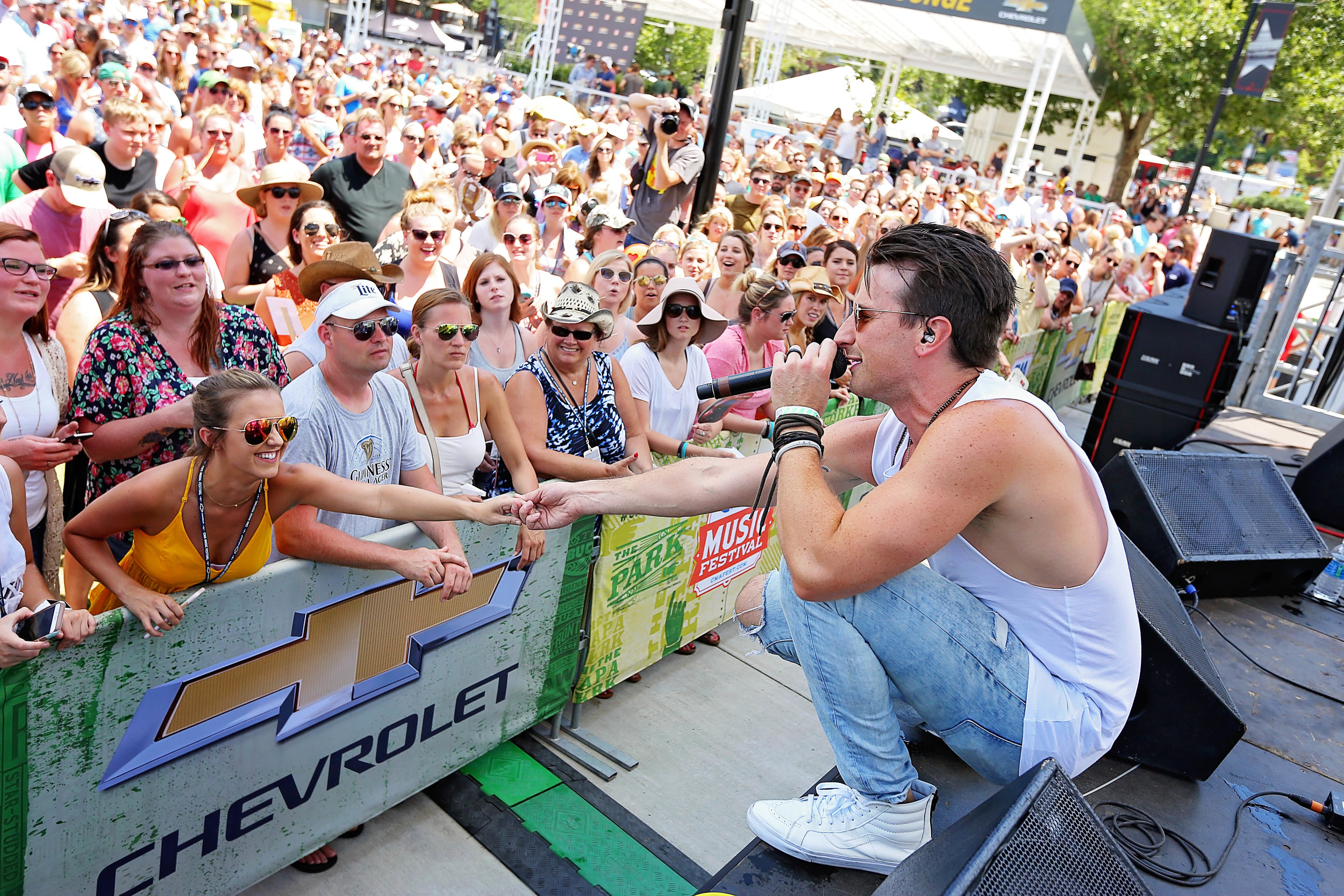 Russell Dickerson performs at the Cheverolet Cruise Park During CMA Fest