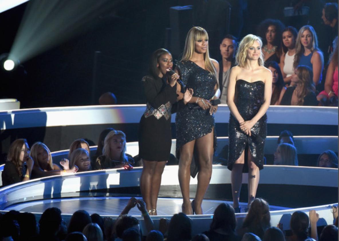 Laverne Cox, 2014 MTV VMAs. Wearing a Marc Bouwer dress, Johanna Johnson handchain, Neil Lane bracelet and Lynn Ban earrings.