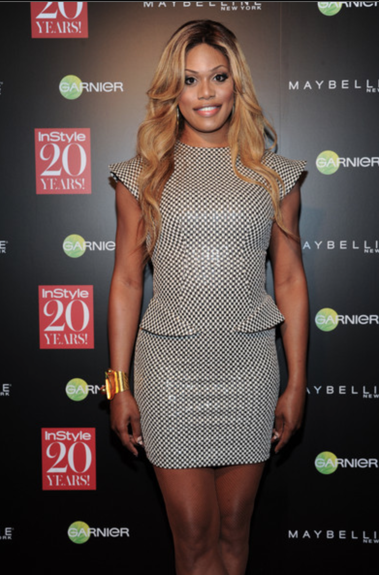 Laverne Cox at the InStyle Magazine 20th Anniversary Party. Wearing Marc Bouwer, Valentino shoes and jewelry by Alexis Bittar and Jennifer Miller