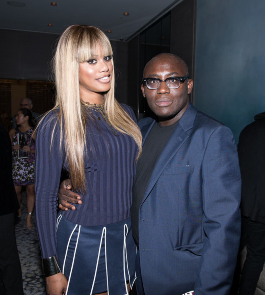 Laverne Cox at the 2014 Fashion Media Awards with Edward Enninful. Wearing Kenzo and Alexis Bittar jewelry