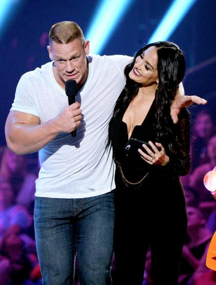 Nikki Bella with John Cena hosting the Kids' Choice Awards