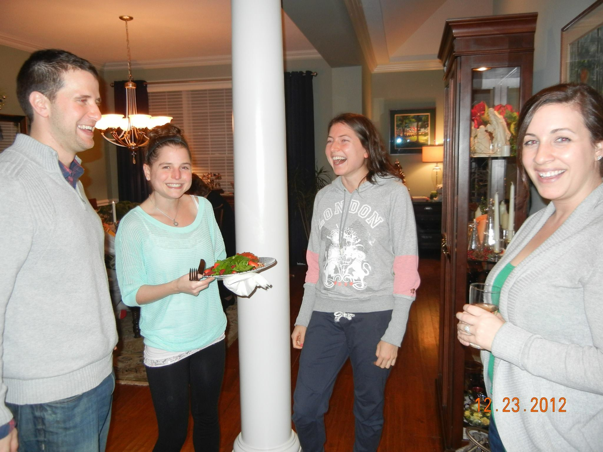 Ian, my sister Jill, me, and Ian's wife Sarah at Christmas at Aunt Judy's house in 2012.