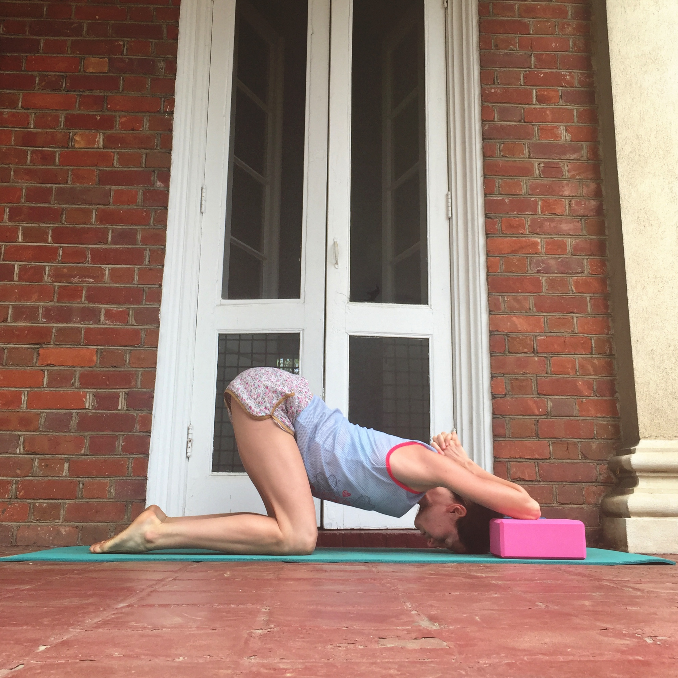 7. SHOULDER OPENER WITH BLOCKS.    Using two yoga blocks (or pillows, or books with a few blankets stacked on top), plant one elbow onto each block. Sink forehead towards the floor. Sink bum towards your heels. Stay as long as you like!