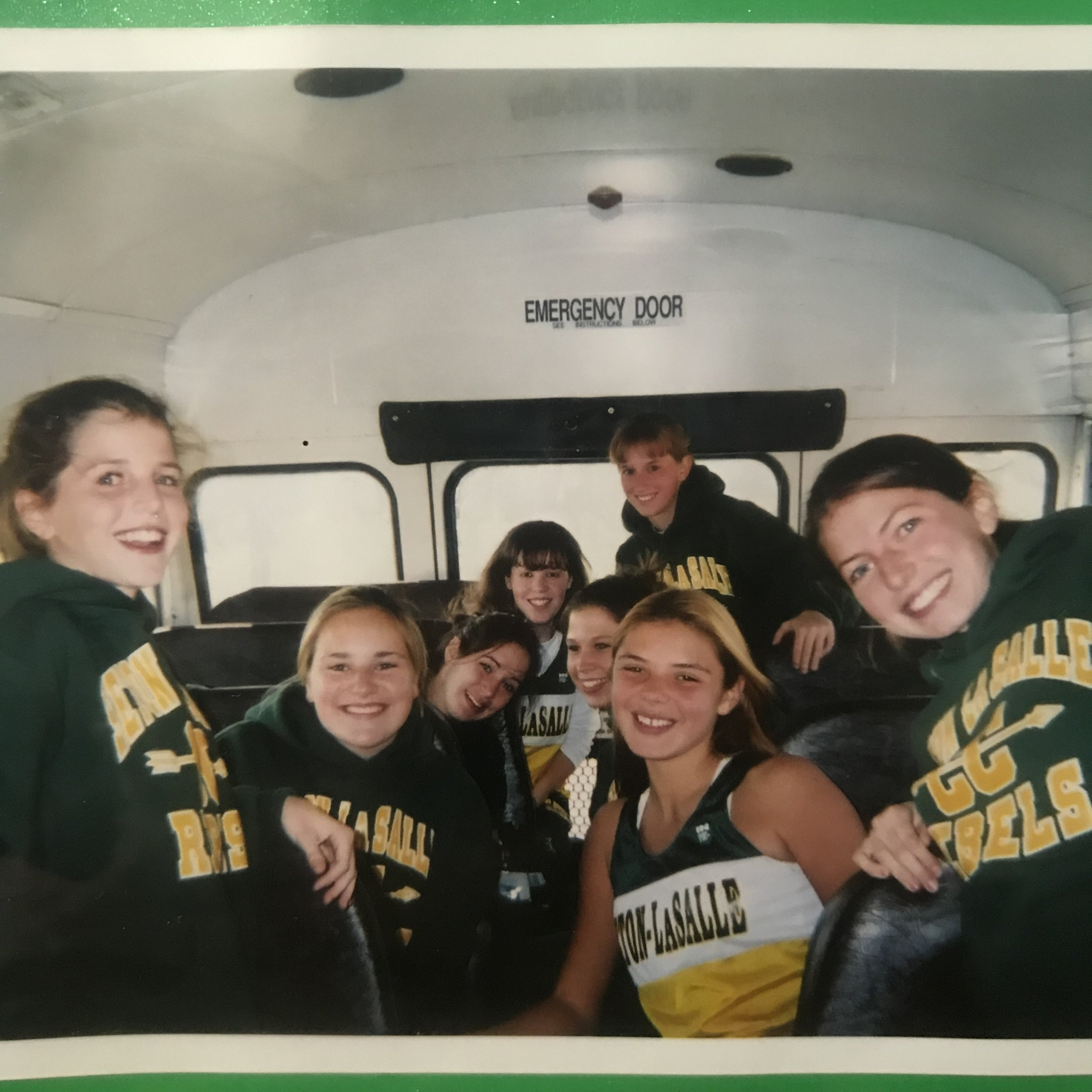 On the bus back from WPIAL XC Championships during high school: I'm on the right and my sister Jill is on the left in the foreground here.