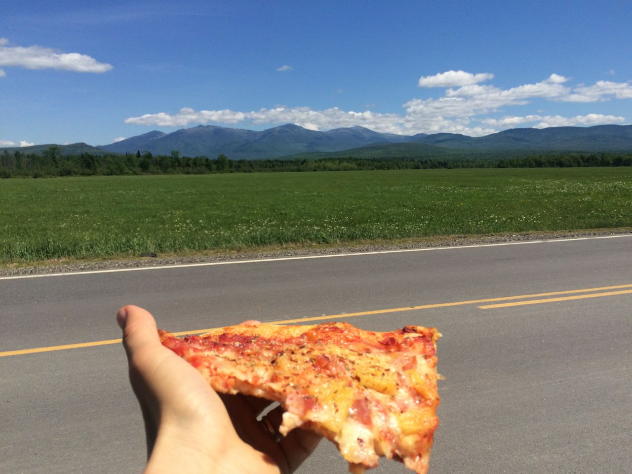 Day 5 - Wow, what a spectacular day along the Presidential Range between Lancaster and Bretton Woods, NH. I had vectored off course to find cell service, leaving Dad with a trek angel (awesome support person) and ran into this piece of pizza. (smile) On the way back to the trek route, I stopped the car on the side of the road. It was magnificent. My iPhone didn't know whether to focus on the pizza or the mountains. Neither did I. It was all awesome.