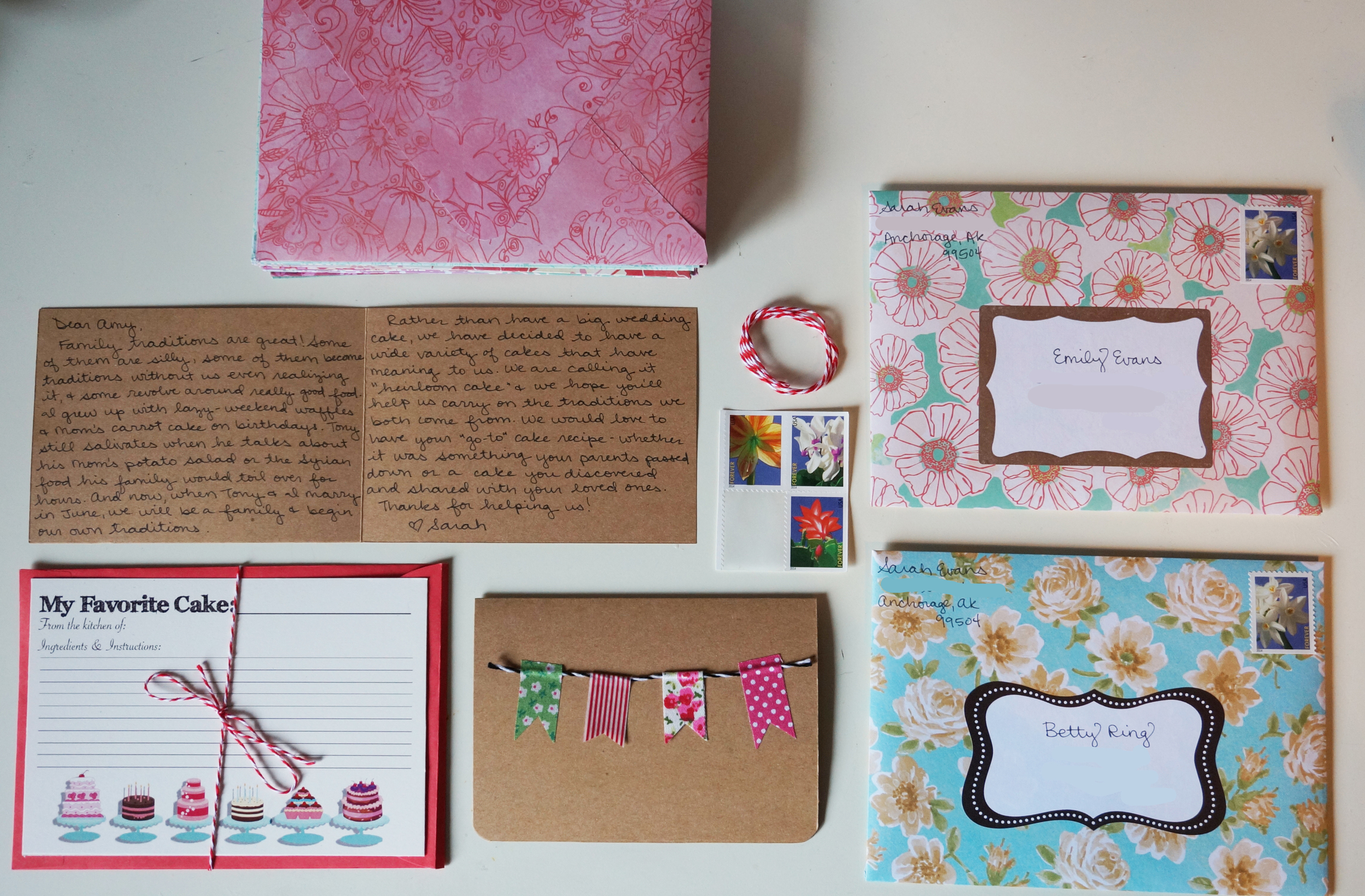 All handmade cards using supplies on hand: homemade envelopes made from scrapbook paper, bunting cards made with cardstock, baker's twine, and washi tape, and recipe card designed in Photoshop and printed at Kinko's for 10 dollars.