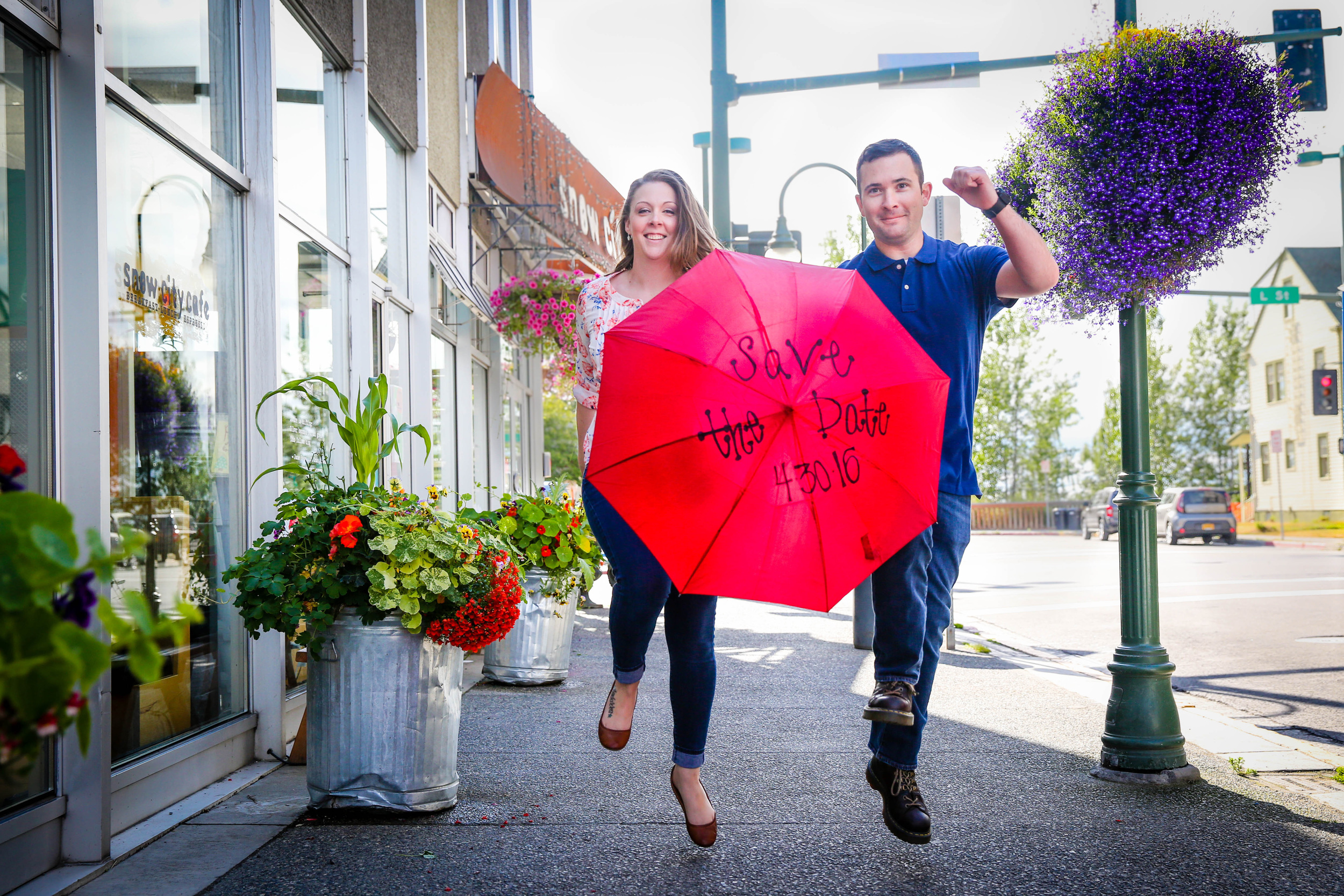 Tanya & Jeremy skipping down the 4th Avenue during their Anchorage Engagement Session.