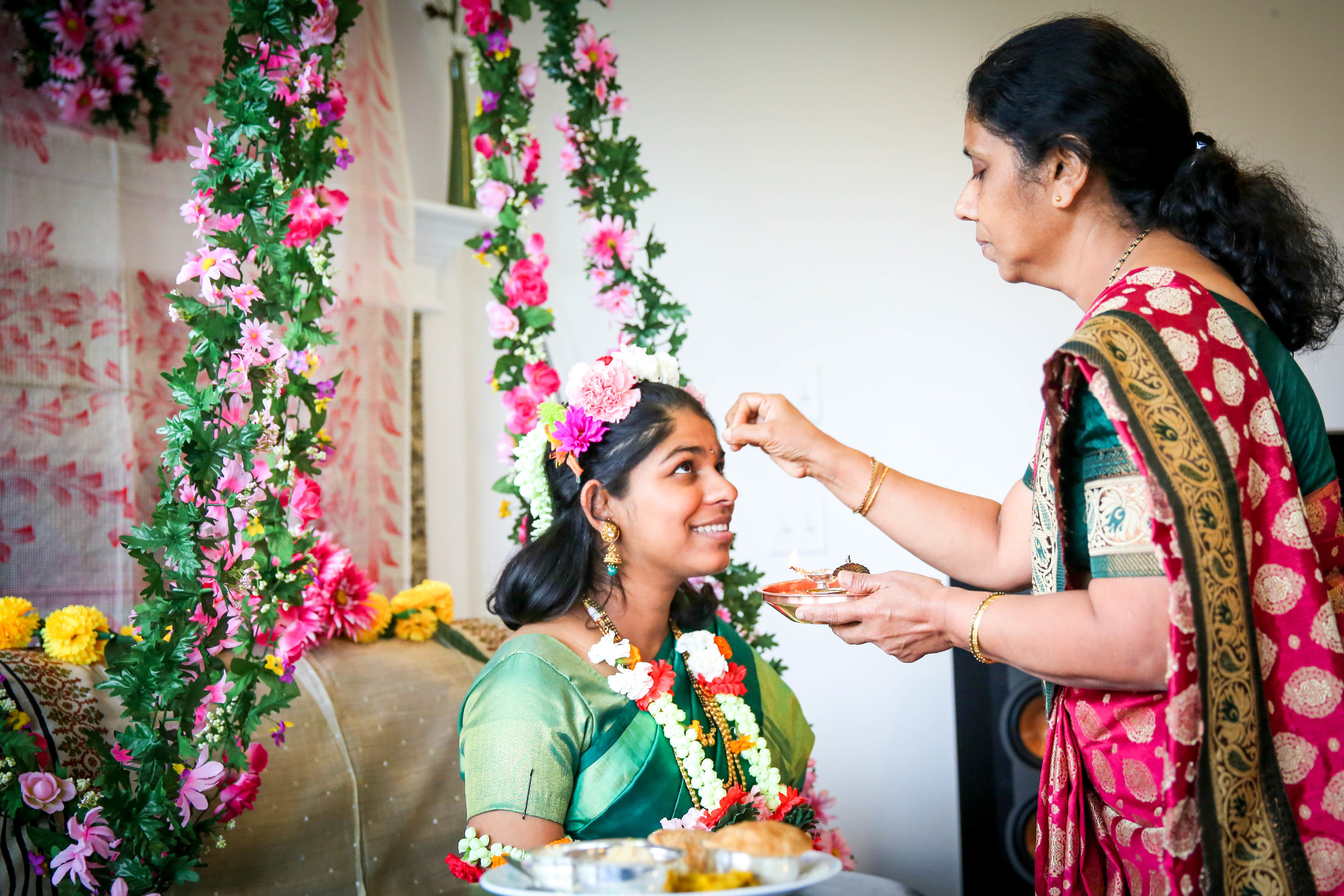 I love this photo! There's something so tender about a mother passing on her blessing to her daughter, who is about to become a mother too. I love the way this photo represents that bond and how Poorva is still looking up to her mother.