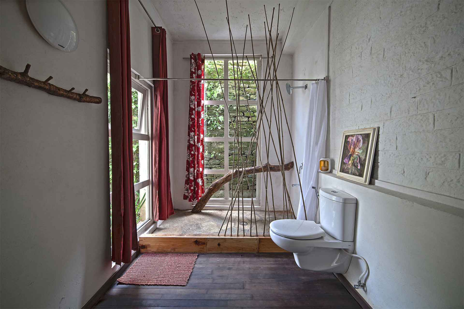 ..a fallen log holding the shower curtain partition - using this bathroom is a joyful experience