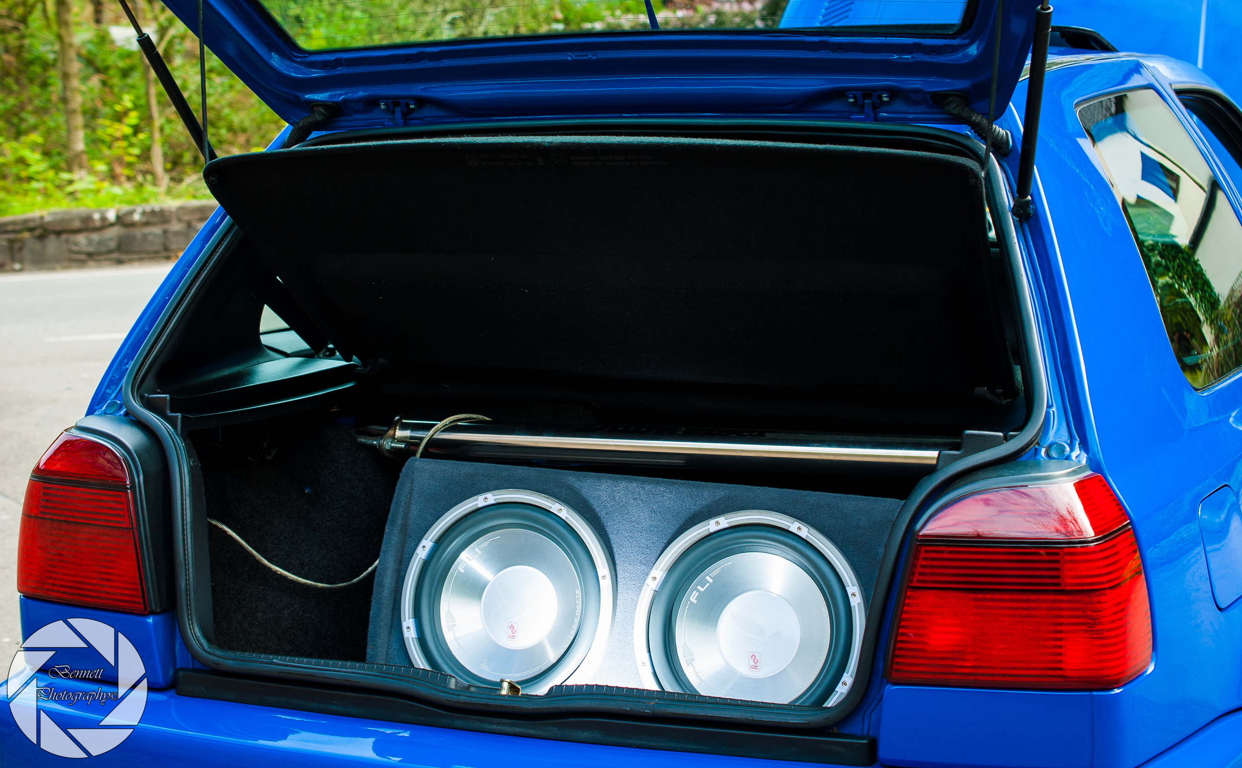 Simple subwoofer install, and tinted taillights fall right into the cars simplistic smooth theme