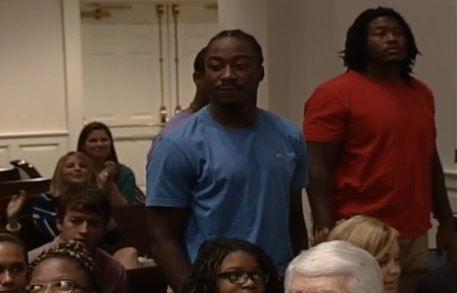 Marcus Lattimore  and  Jadeveon Clowney  come forward at a Team Impact altar call.