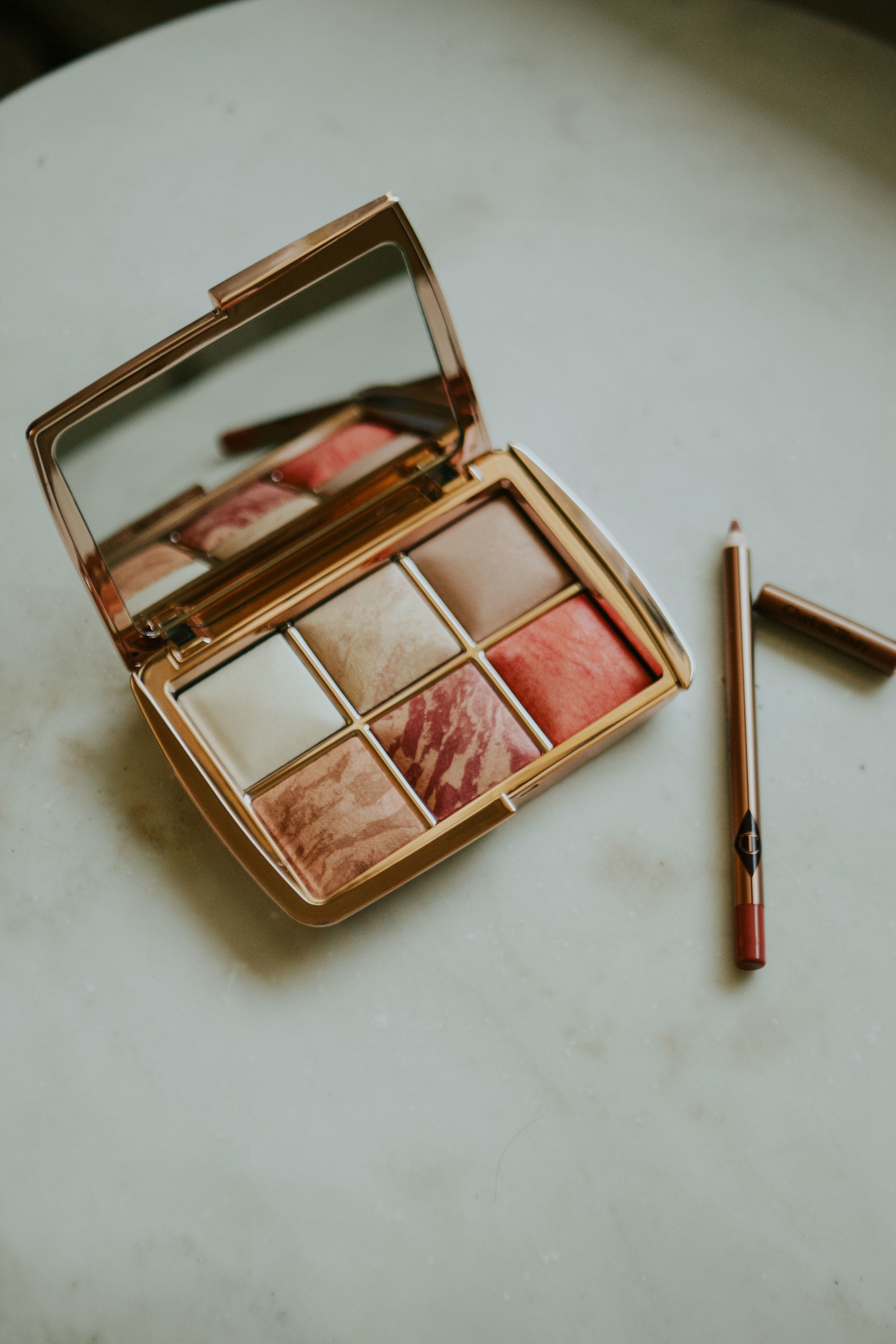 I absolutely love this makeup palette by Hourglass. I'm also currently loving this lip pencil by Charlotte Tilbur,especially in the Pillowtalk color.