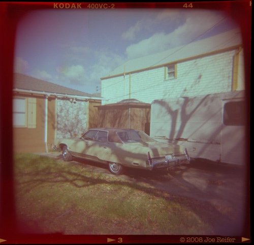 A car, a van, trees, stone facing, what's not to love? -- by Joe Reifer