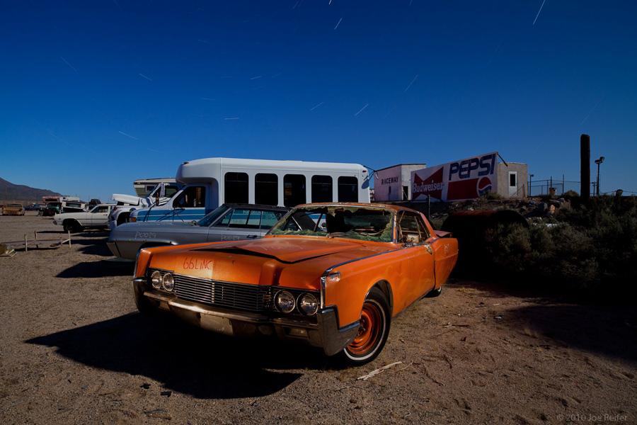 Burned orange 1966 Lincoln with flame job -- by Joe Reifer