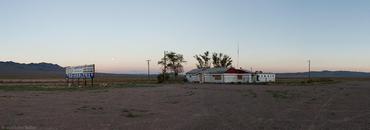 Sunset and moonrise over abandoned Nevada brothel -- by Joe Reifer