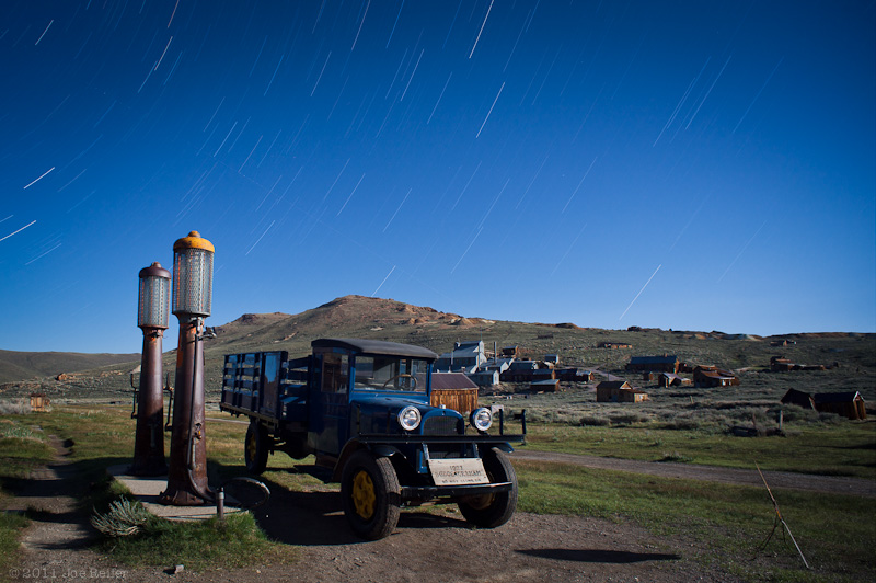 Bodie at night: 1927 Dodge truck and gas pumps -- by Joe Reifer
