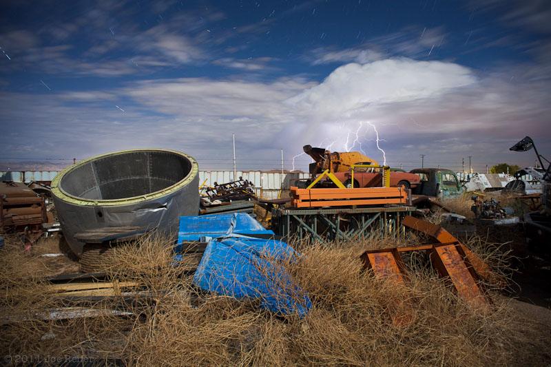 Lightning over vehicles, nacelle, and detritus (Paul's Junkyard) -- by Joe Reifer