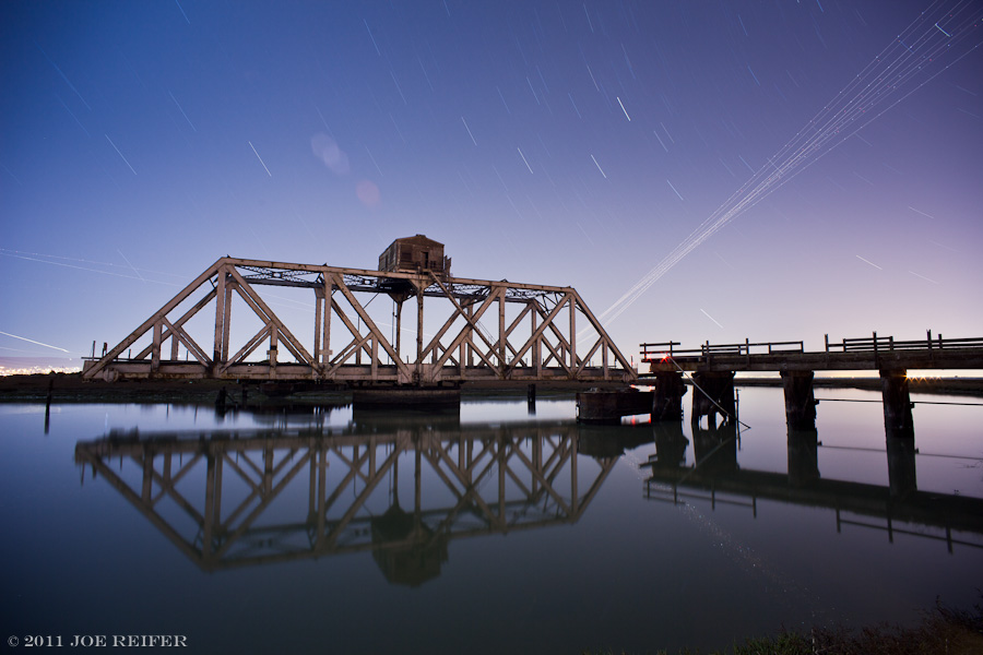 Dumbarton swing bridge with star trails and airplane trails -- by Joe Reifer
