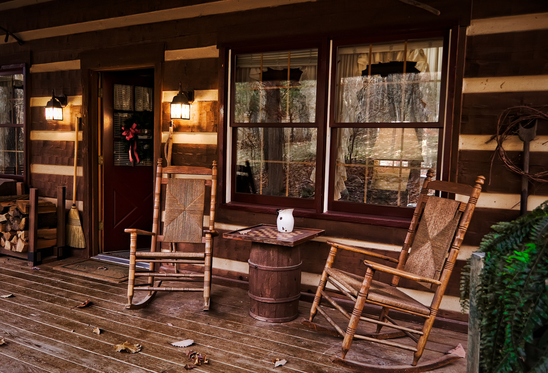 cabin front porch chairs and table.jpg