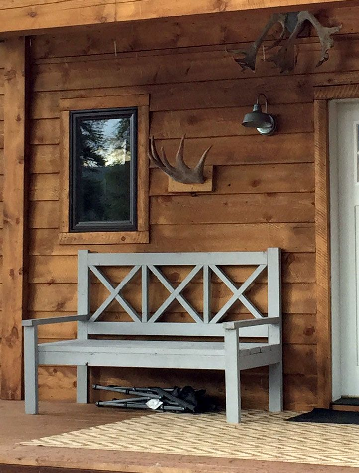 cabin front porch mounted antlers.jpg