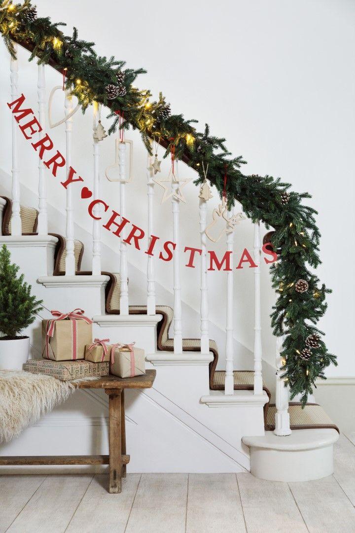 Christmas cabin banister garland.jpg