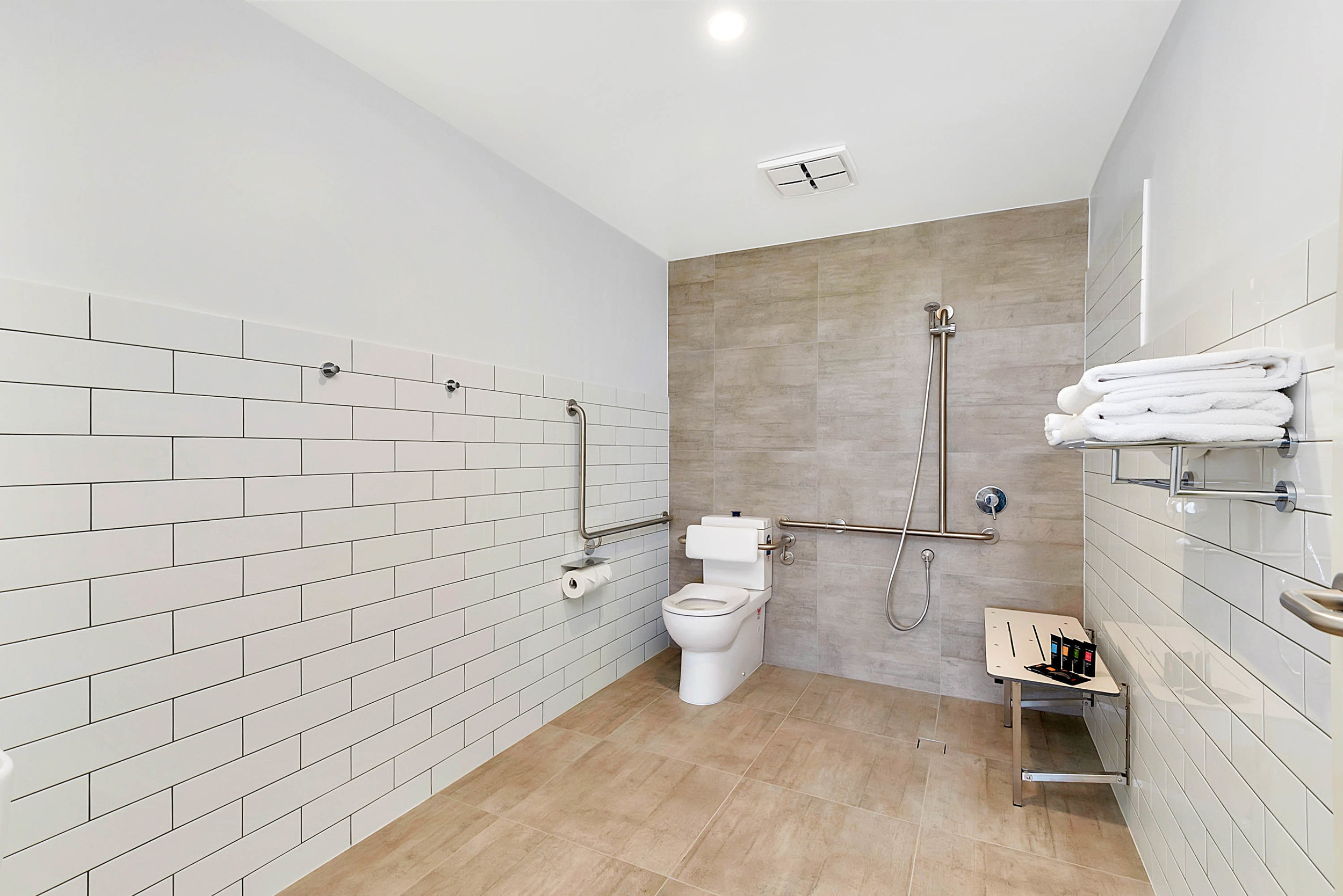 The accessibility bathroom has safety bars in the shower and toilet with adequate clear turning space and built-in shower transfer (AS 1428.1 compliant). and extra floor mats can be provided on request for the bathroom