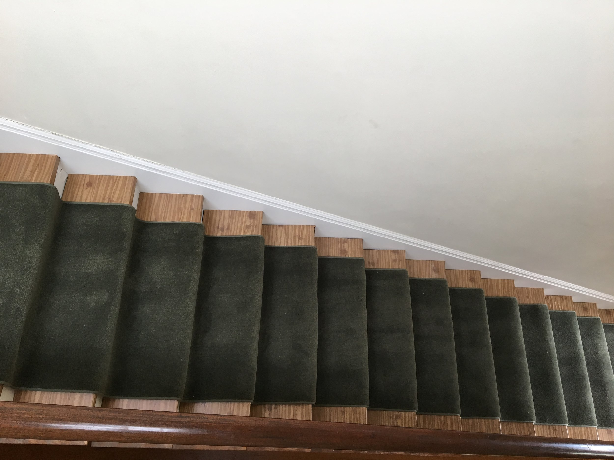Finished stairs with stunt foam and plush carpeting