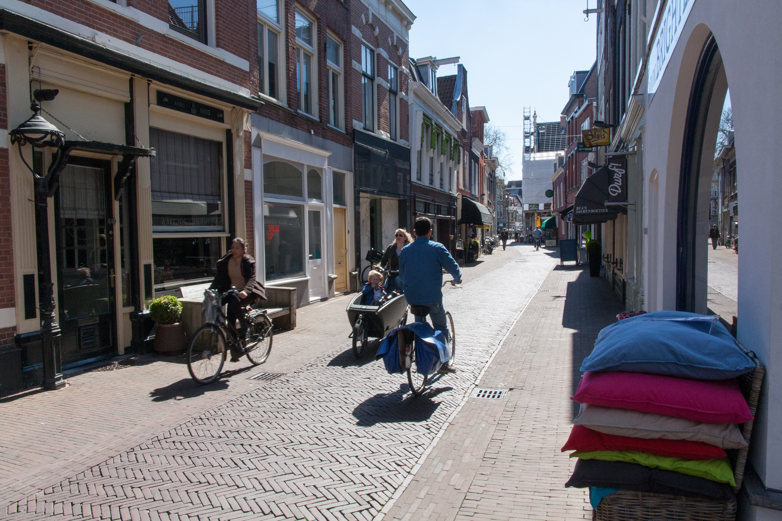 Narrow city streets like this in some places make choosing to ridea bicycle no question. Sometimes thee streets are congested with pedestrians on both sides and cyclists in the middle, making driving to these places impractical, and some days if there is a delivery truck, impossible!