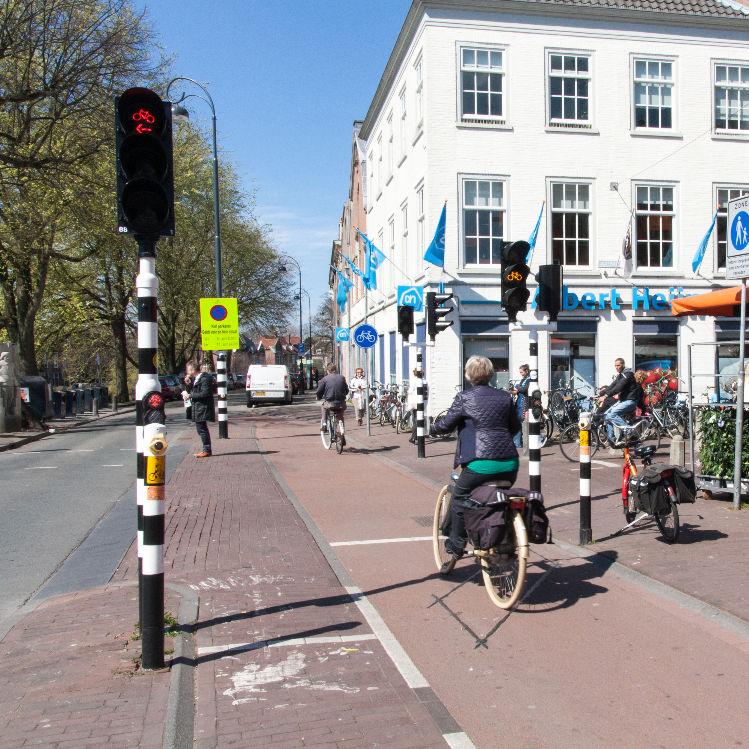 These traffic lights for cyclists turning left and going straight are at most busyintersections where cyclists and pedestrians interact.