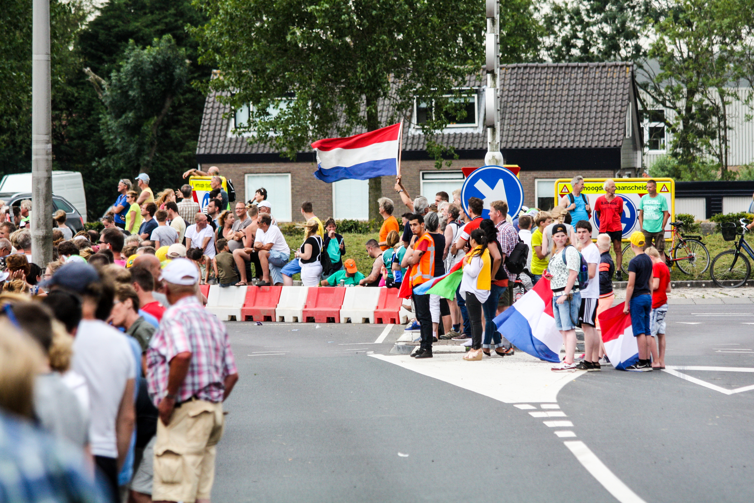 Dutch flags set the scene in the town of Gouda and thousands of people lined the side of the road for hours to see 30 seconds of pro-cycling. We spent a lot of time chatting with people around us and enjoying the positive atmosphere.