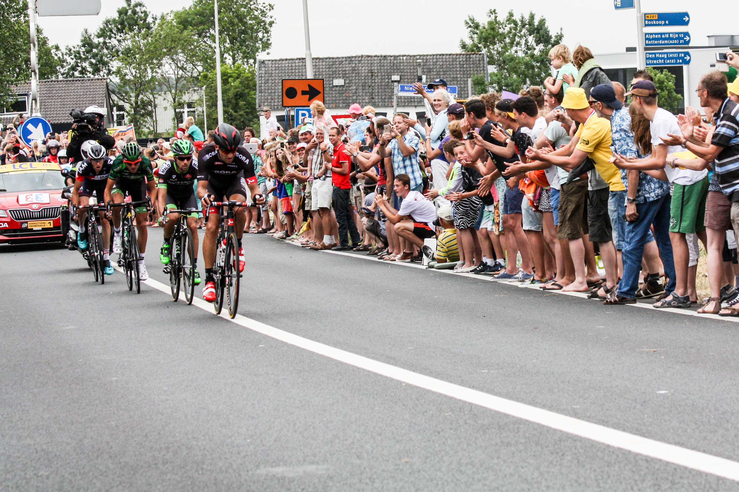 As a half dozen helicopters hovered near the city, we knew the riders were approaching. These where the leaders of the stage at this point on the north edge of Gouda.