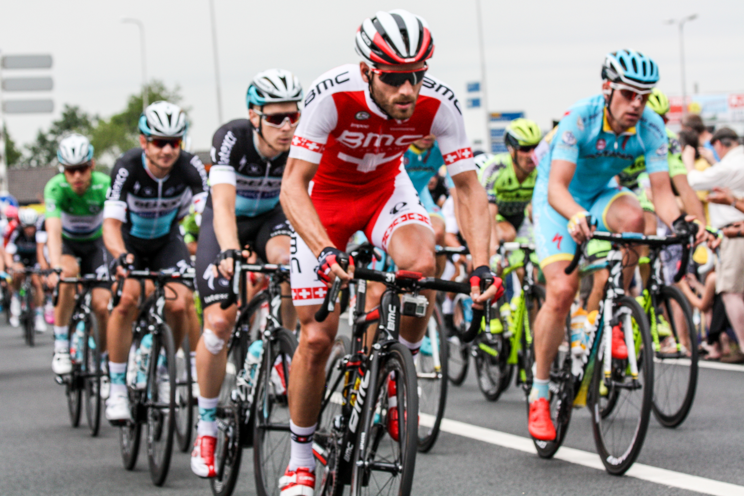 """Thirty seconds or so after the leaders passed by, we saw this """"peloton"""" of over a hundred riders speed by in a matter of seconds."""