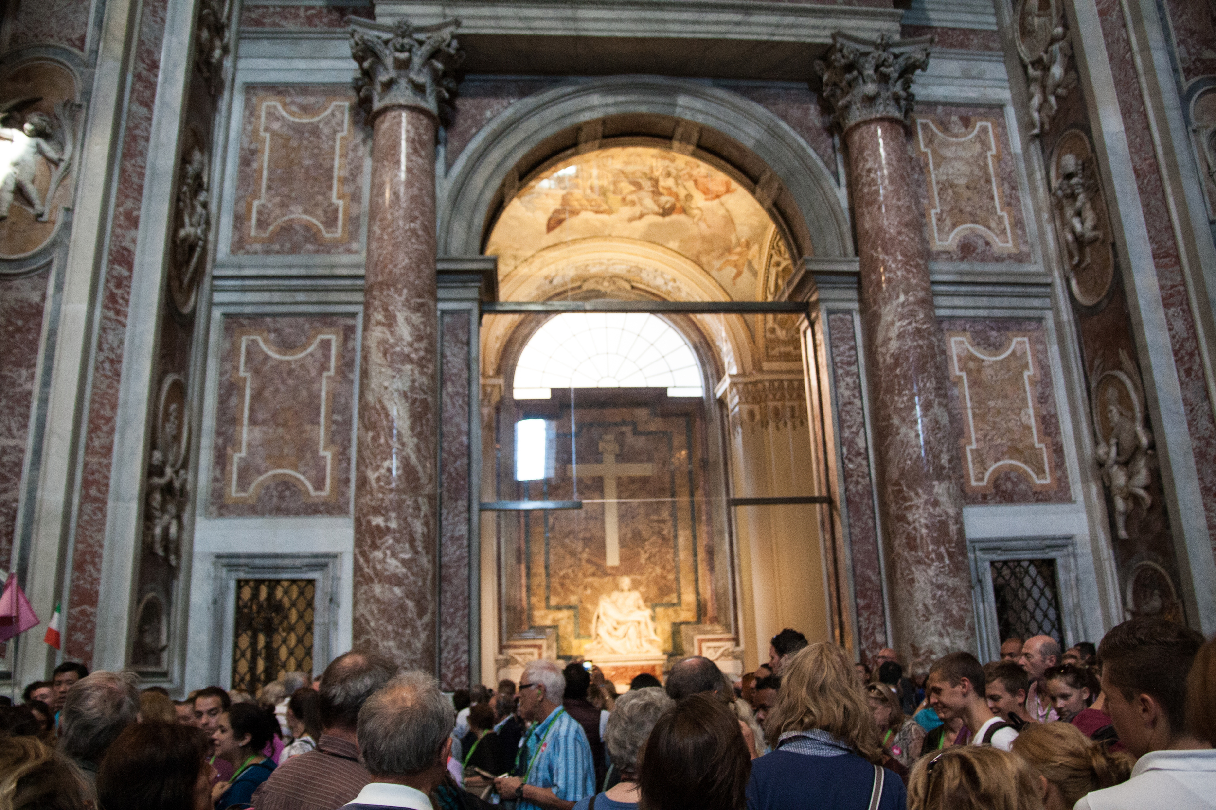 The Pietà  (Michelangelo) in St. Peter's Basilica sits behind bulletproof glass