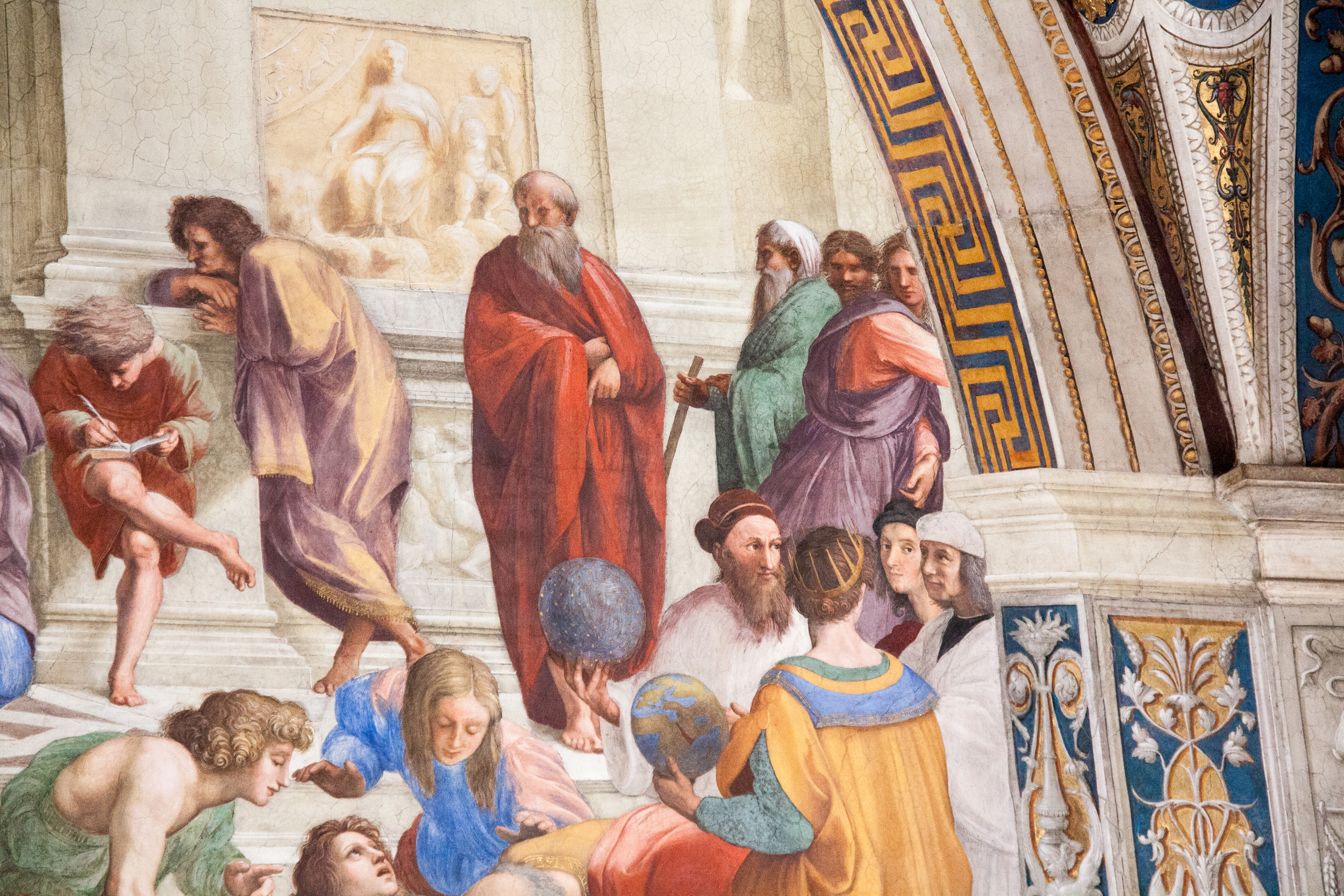 Raphael's self-portrait in  The School of Athens  (Raphael) is the second figure peeking out past the right, forefront column, dressed in red with dark hair