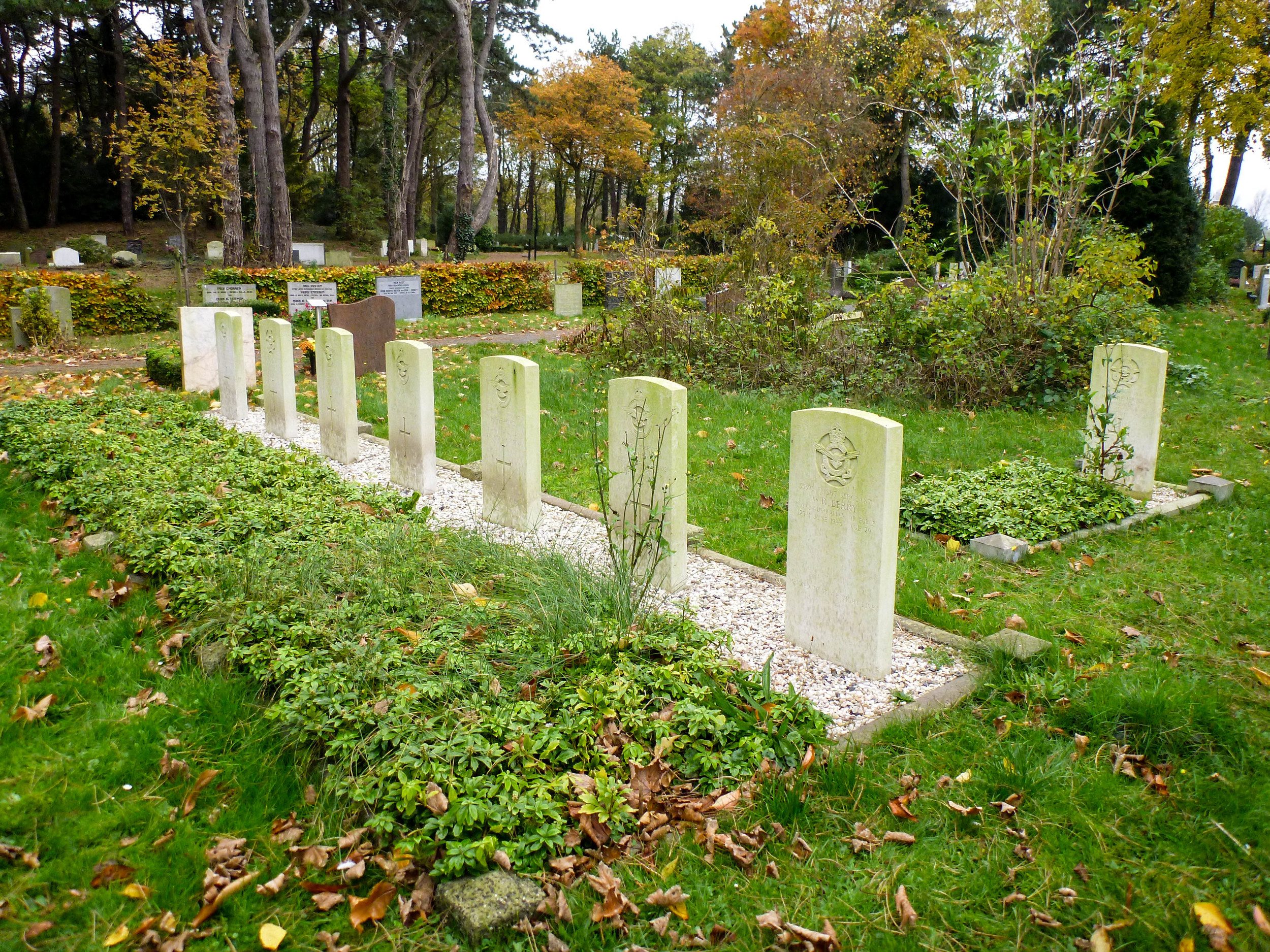 The seven graves in front are Keith and crew. Behind to the right is Howard. The rest of Howard's crew is buried elsewhere in The Netherlands.