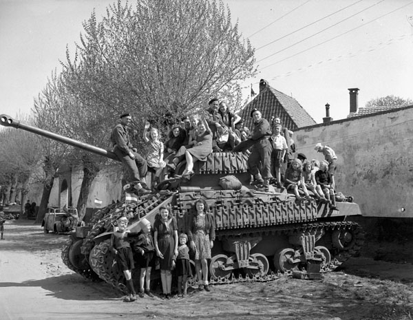 Dutch women and children sitting on a tank of Lord Strathcona's Horse, the same unit as Peter. The photo is from two days after his death.   April 19, 1945 in   Harderwijk, Netherlands. - Source:  Bevrijdings Museum