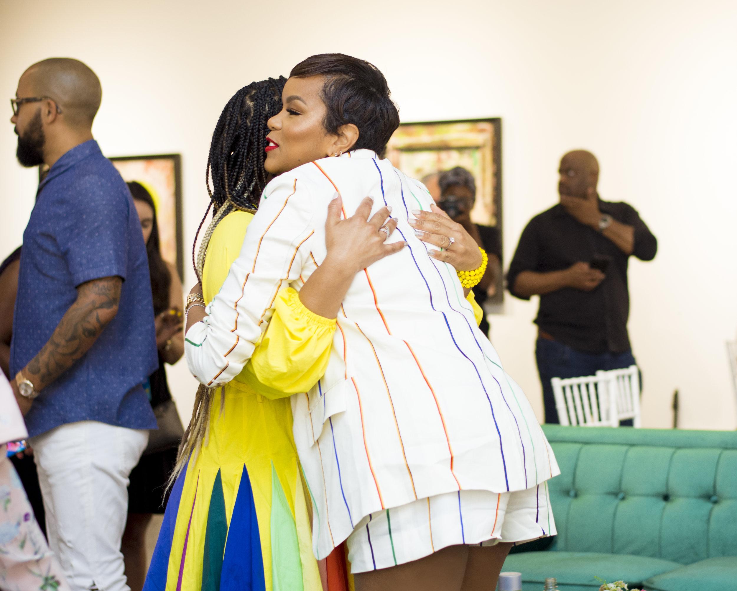 Latoya Luckett embracing Erica Campbell.