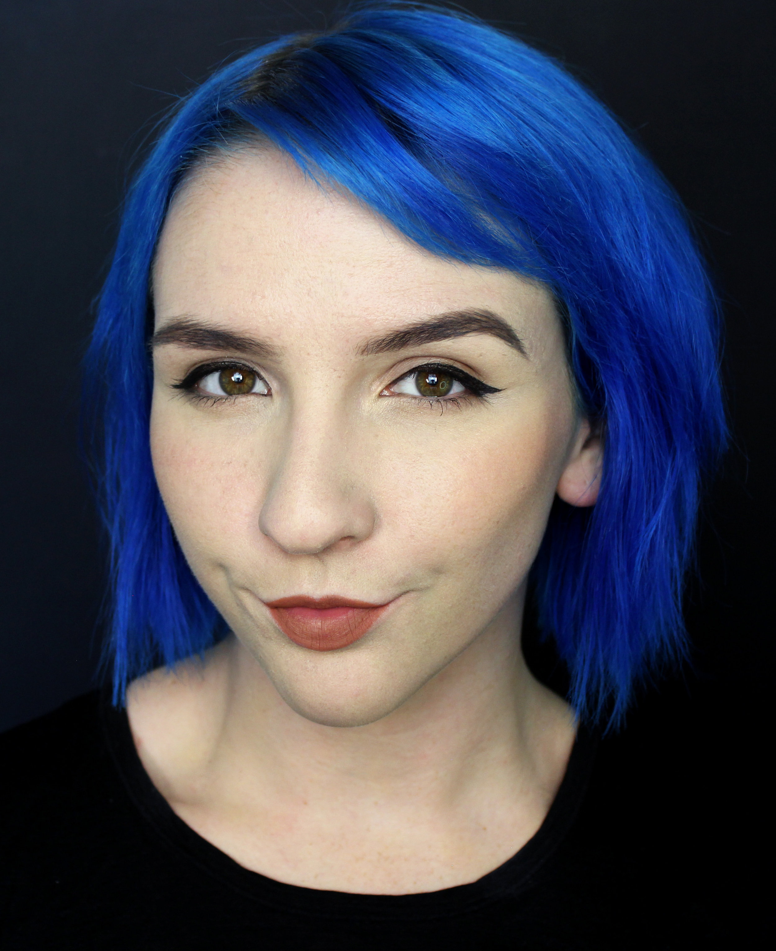 Georgina Ryland Headshot Blue Hair crop.jpg
