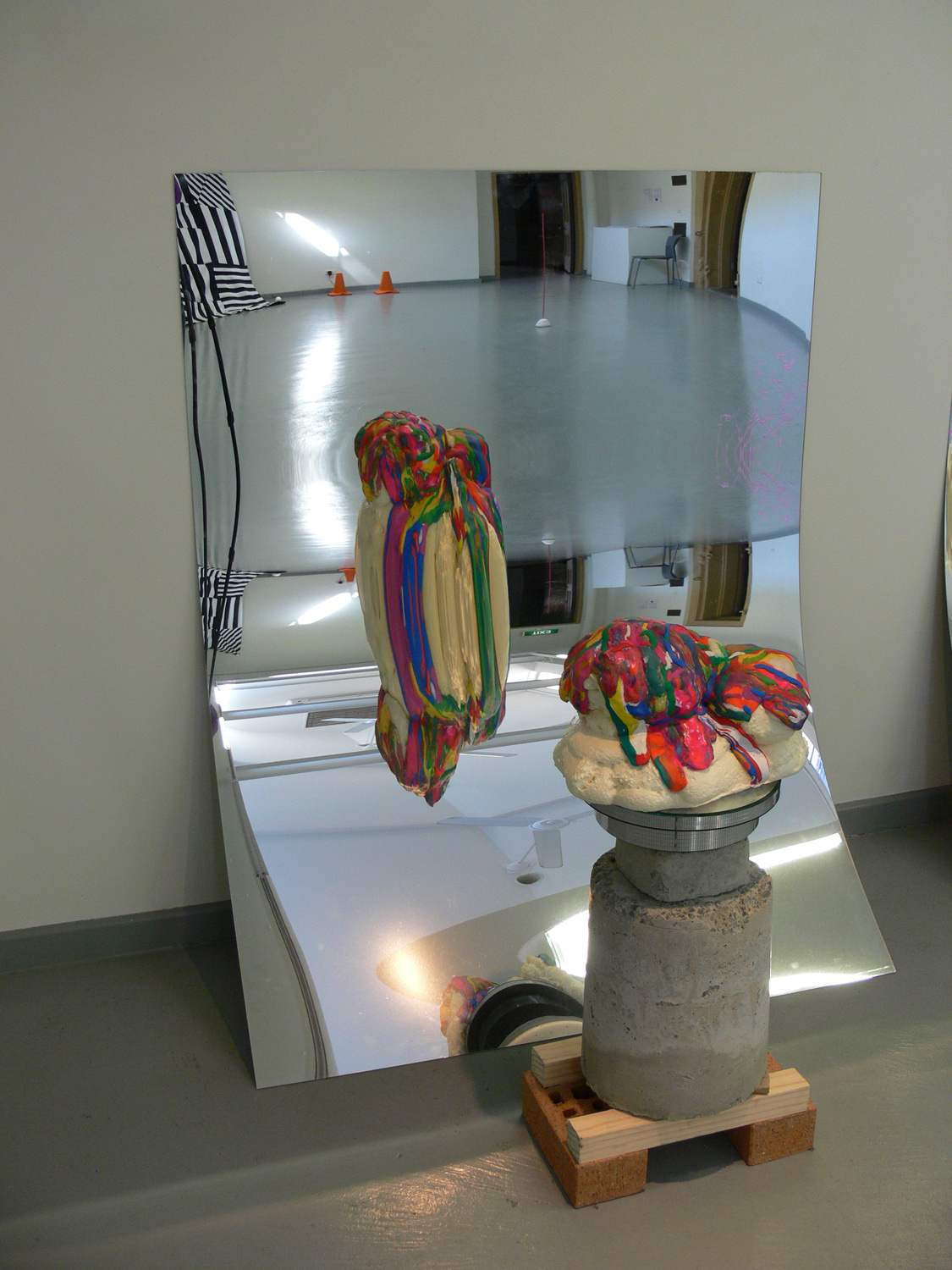 Over and Over and Over (detail) (2011), sculpture on rotating stand made from expandable foam, polymer clay, varnish, concrete, bricks wood and acrylic mirror, 16 x 9 x 31 inches (mirror 5 x 3 ft)