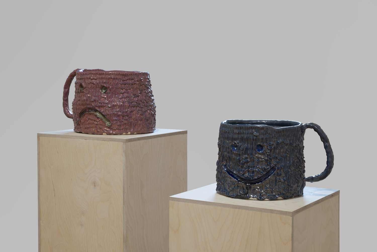Both Ends (2016), raku and lustre glaze on ceramic, 17 x 12 x 12 and 16 x 10 x 10 inches