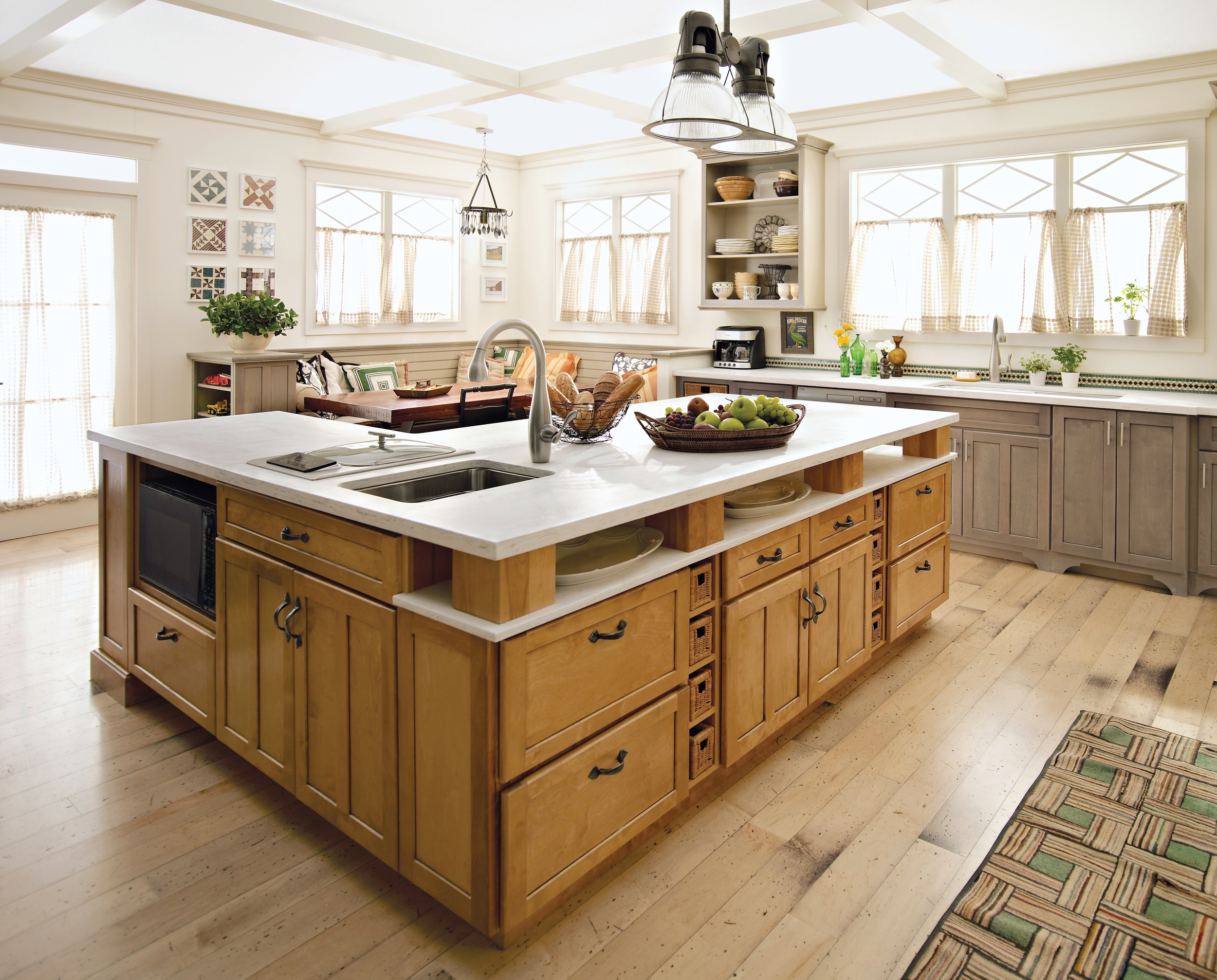 A country inspired design with an open kitchen floorplan and large island