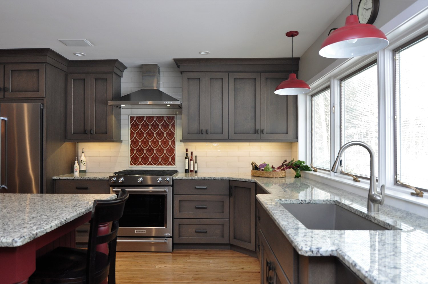 Designed by Erica Smith CMKBD, CAPS / Plato Woodwork (and Prelude) Cabinetry, Full Overlay Anthem Door Style, Quartersawn Oak with Coast Grey Stain with a Black Glaze (Island in Cottage Red Paint with Black Glaze) / Moon Light Granite Counter Tops