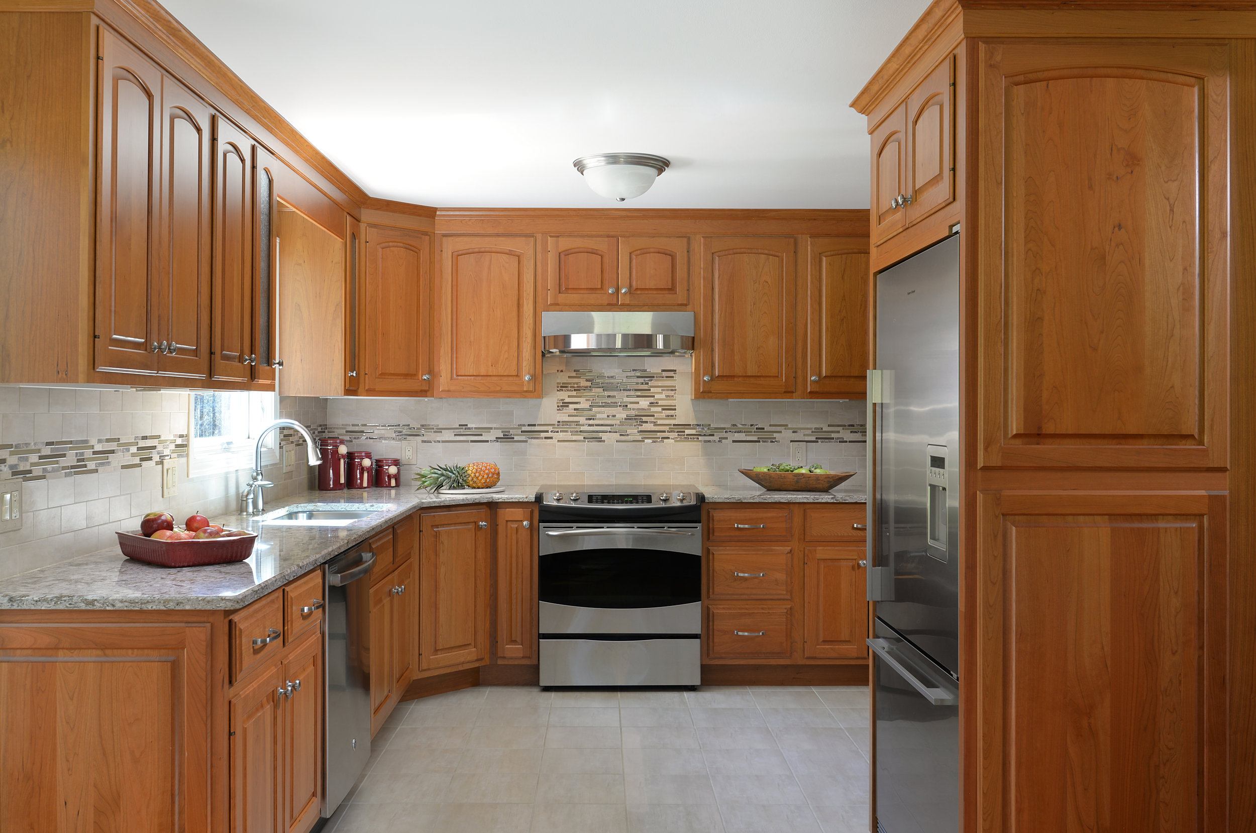 """Designed by Solana James CKD / Candlelight Cabinetry, 3/8"""" Lipped Classic Arch Door Style, Cherry Wood with Honey Glow Stain / Cambria Windemere Quartz Counter Tops"""