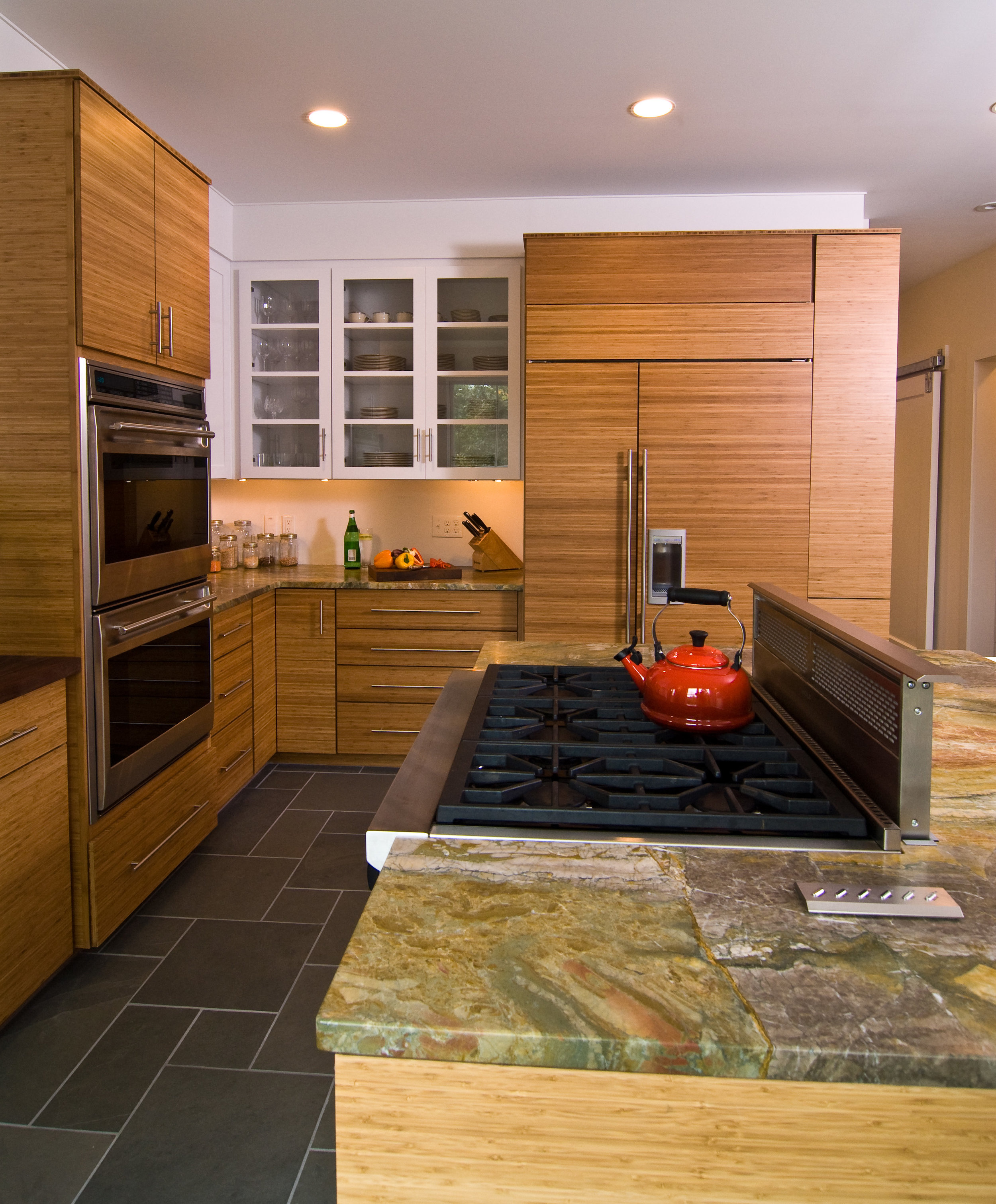 Designed by Erica Smith CMKBD, CAPS / Plato Woodwork, Caramelized Horizontal Grain Bamboo and Arctic White Painted Cabinetry