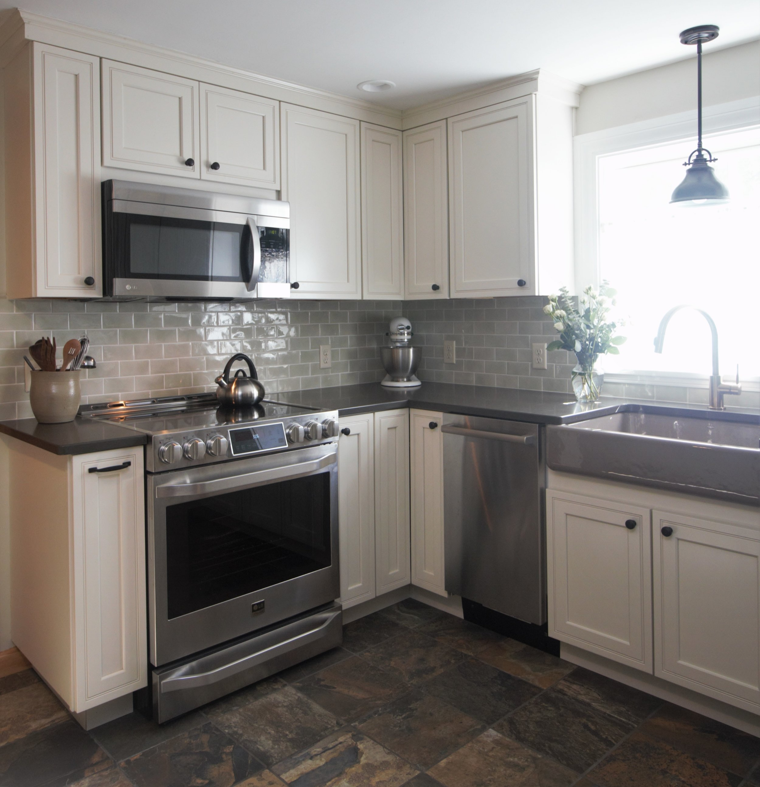 Designed by Solana James CKD / Kraftmaid Cabinets, Full Overlay Argonne Door Style, Maple Wood with Canvas Painted Finish / Caesarstone Pietra Grey Quartz Counter Tops