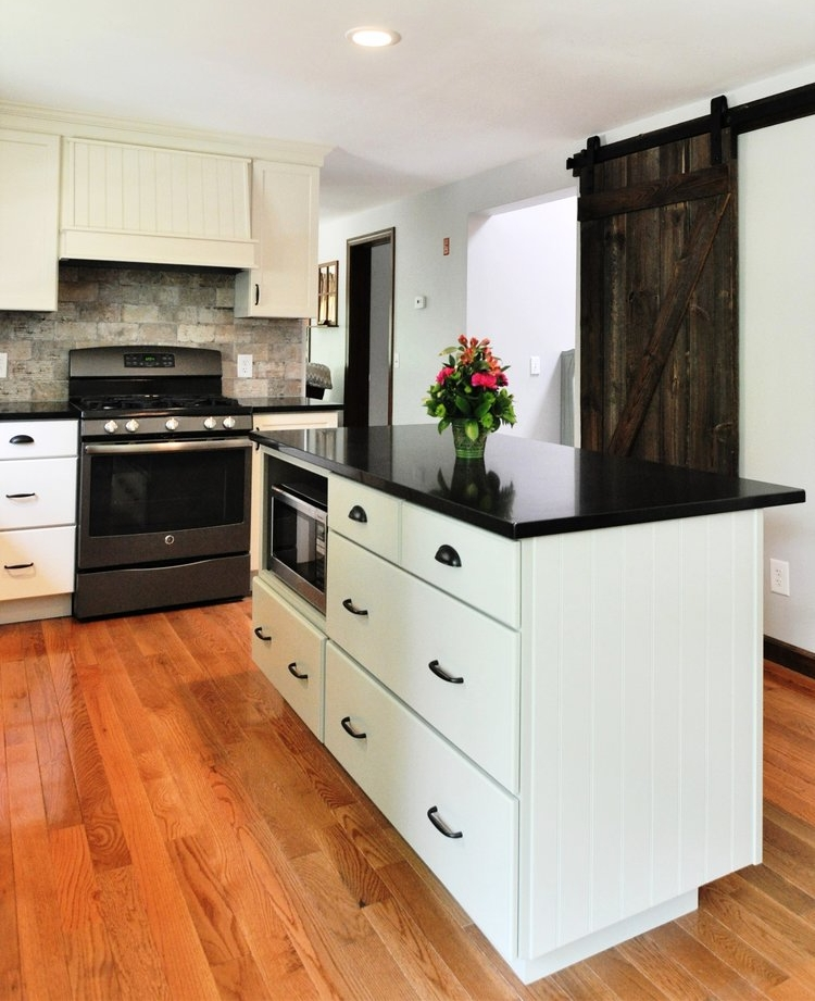 Designed by Erica Smith CMKBD, CAPS / Vantage by Kraftmaid Cabinetry, Full Overlay Grandview Door Style, Maple Wood with Canvas Paint (Willow Paint on Island) / Silestone Tebas Black Quartz Counter Tops