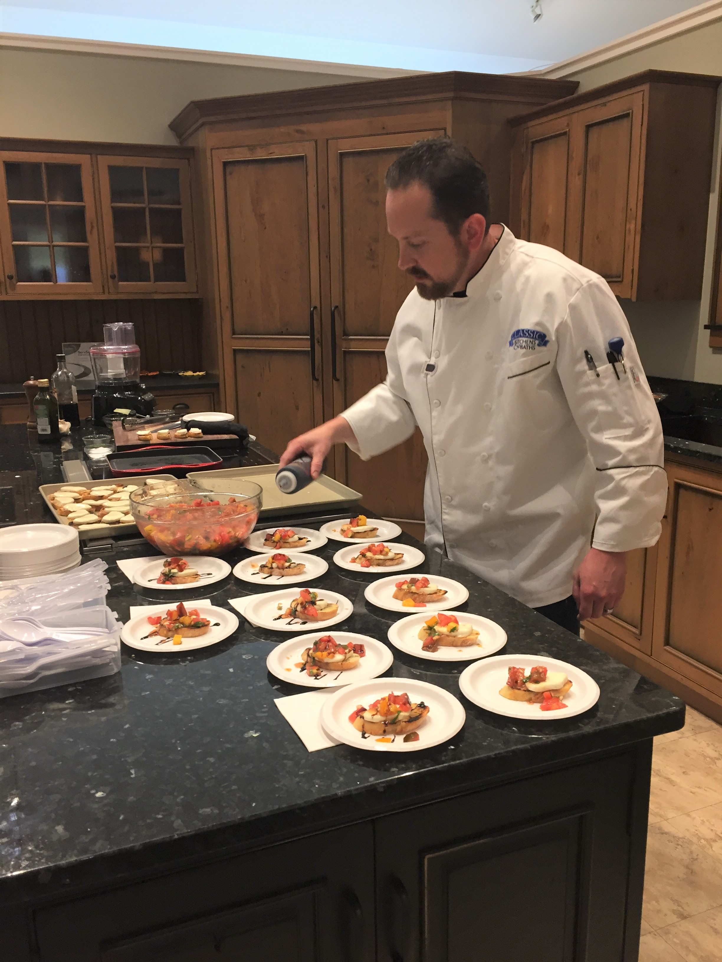 Shawn Kelsey preparing appetizers at Classic Kitchens 30th Anniversary Party on 9/30/2017