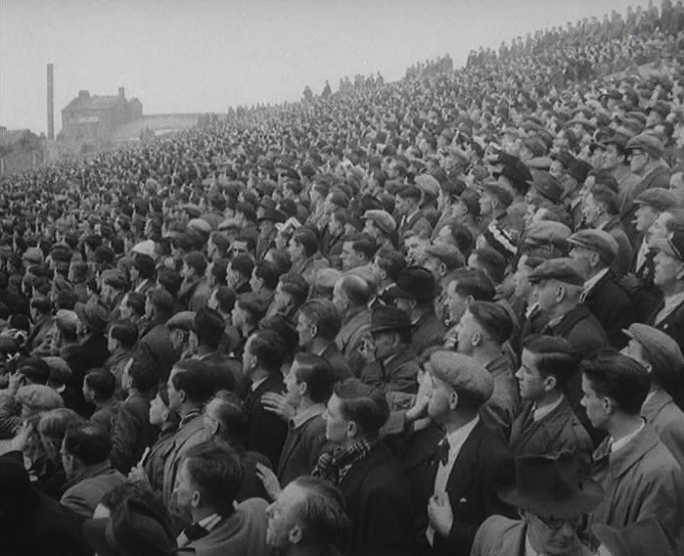 Suited fans watch Swansea vs NorthBank - circa 1950s